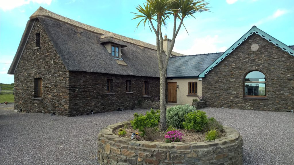 Reed Thatched Roof with Gable Dormer window on Stone House
