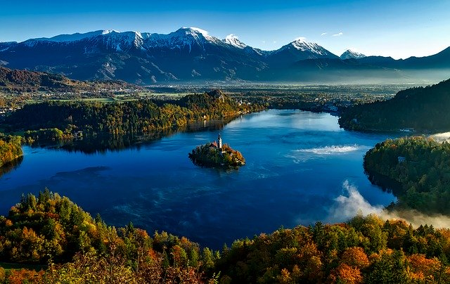 Lake Bled surrounded by mountains and forests. Beautiful Slovenia.