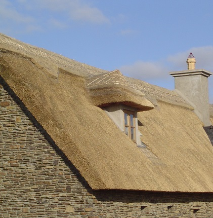 Thatched House with Thatched Dormer Window.