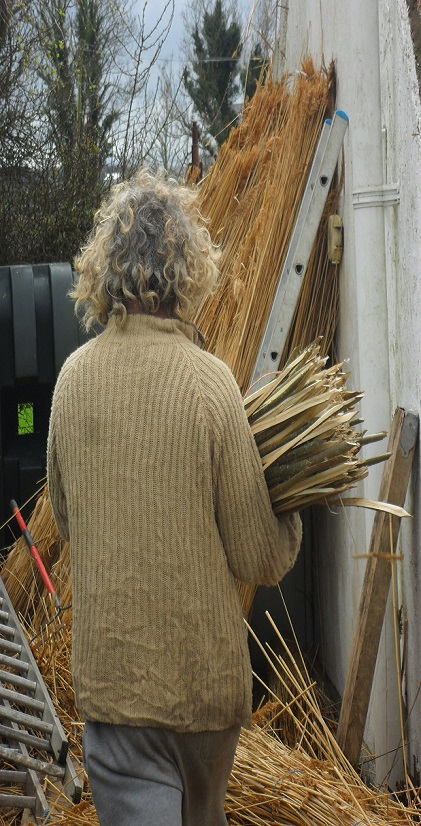 Roof Thatcher carrying Thatching Spars, Thatching Scallops.