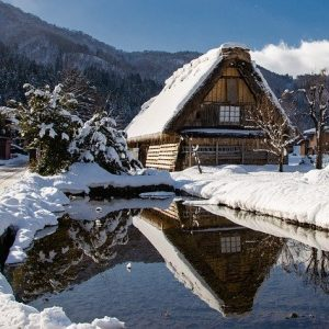 Beautiful thatched house under a blanket of snow in Japan.