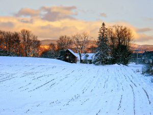 Vermont Farmhouse under a blanket of Snow