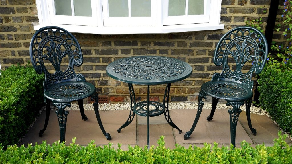Cast Iron decorative garden furniture and box hedging